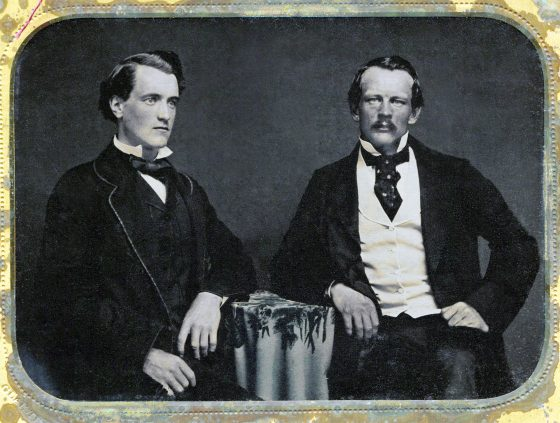 Walter Russell Hall and William Knox D'Arcy (image sourced from Wikimedia Commons]