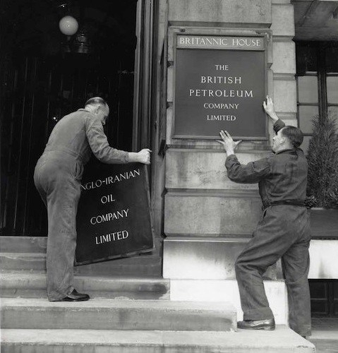 Workers changing the Anglo-Iranian Oil Company sign to British Petroleum at Britannic House in London [image sourced from Stanmore Tourist Board]