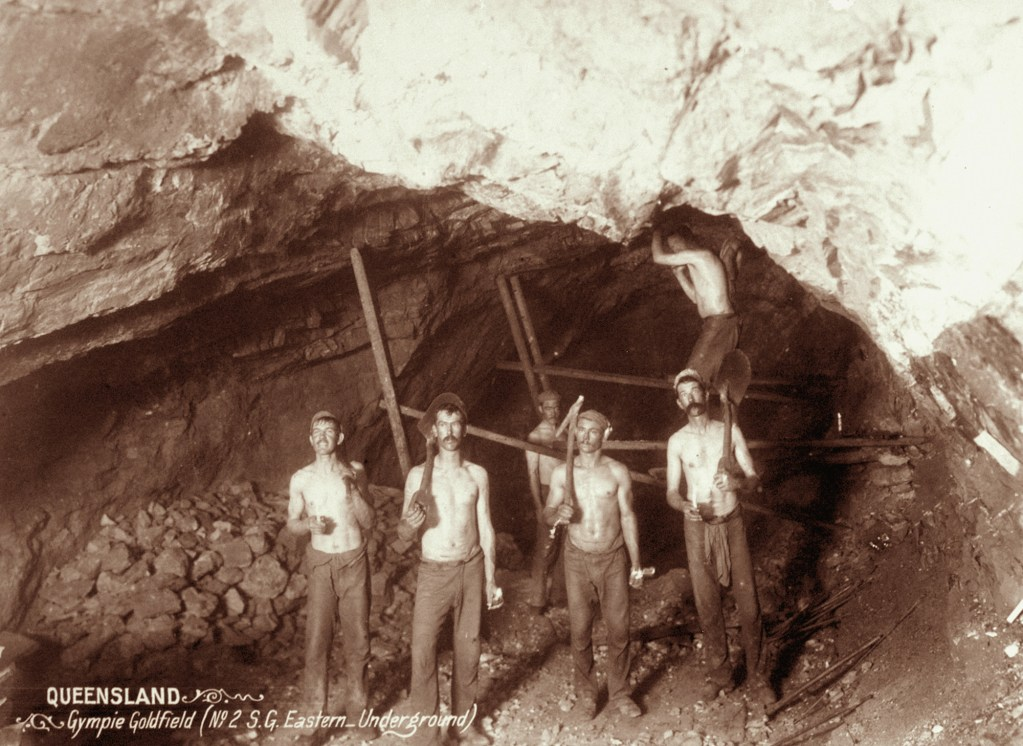 Miners holding tools in a mine shaft, Gympie, 1897